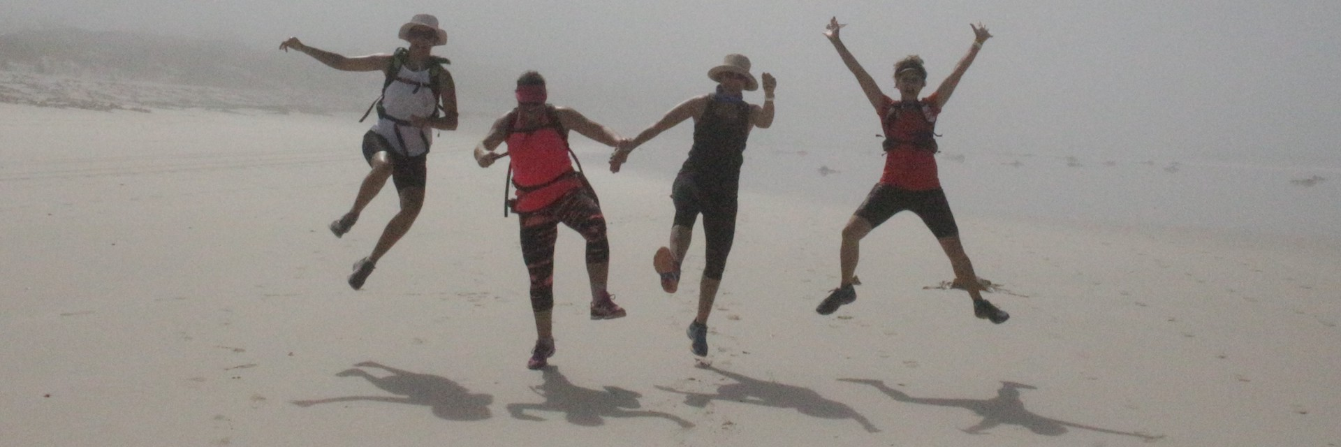 Perlemoen Trail hikers jumping for joy on the beach
